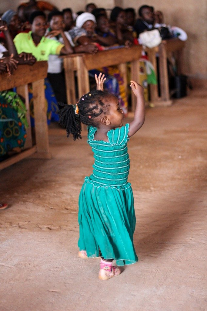 Dancing Rwandan girl. Photo by Hanna Morris on Unsplash