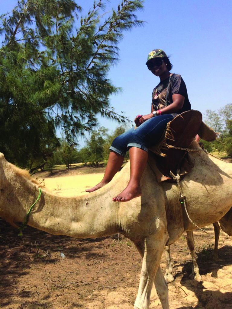Adele Khumalo SAA Cabin Crew Member on a Camel