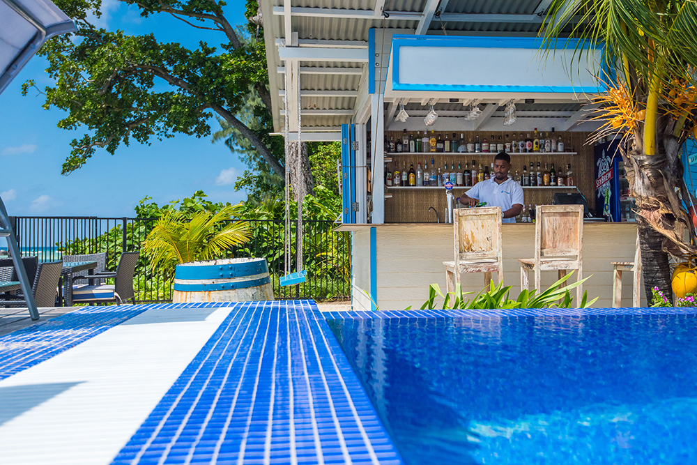 Pool and bar area at Le Nautique La Digue