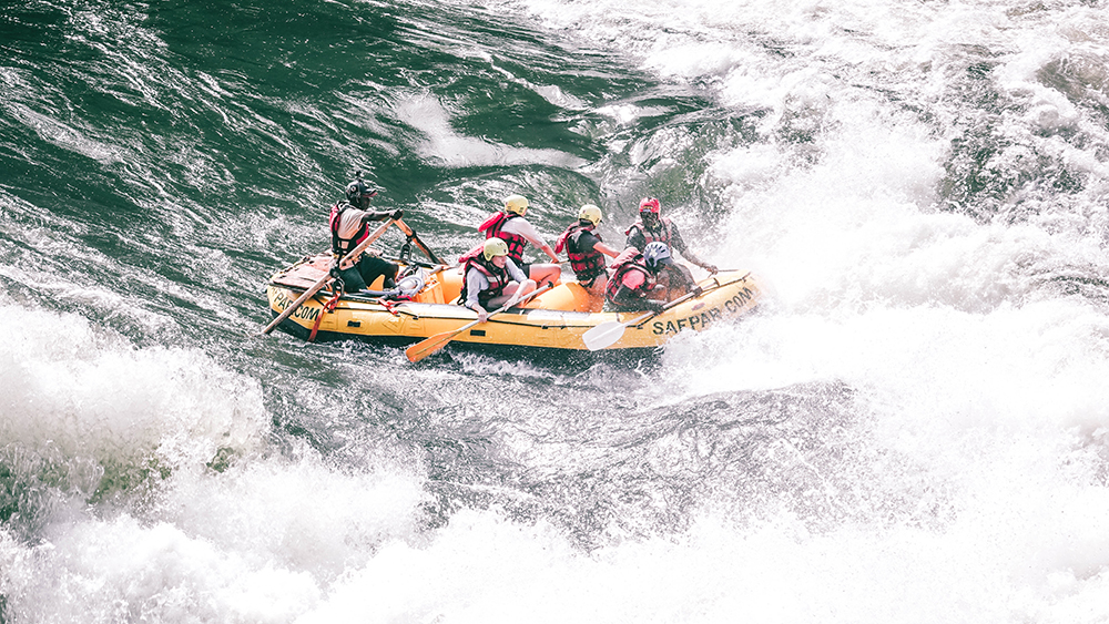 Rafting pro Boyd steers is to safety on the Zambezi River.