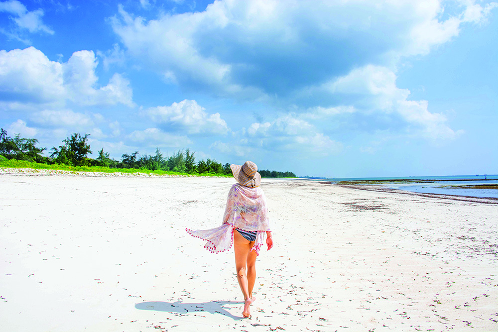 Walking  from the Mida Creek River Mouth takes you along a golden beach. Photo: Melanie van Zyl