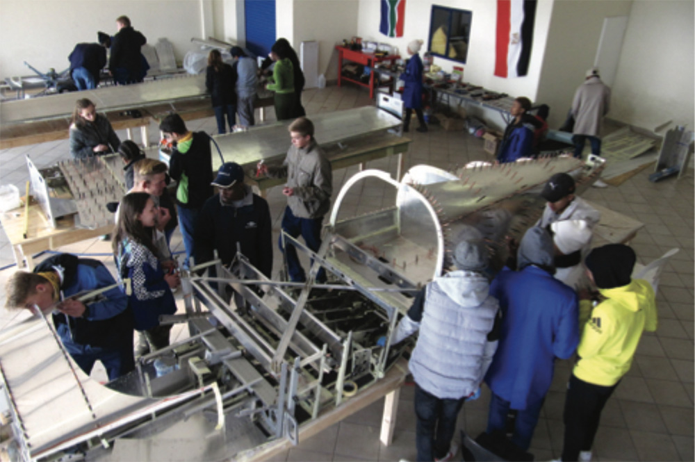 Hard at working building the aircraft that will take them from Cape to Cairo