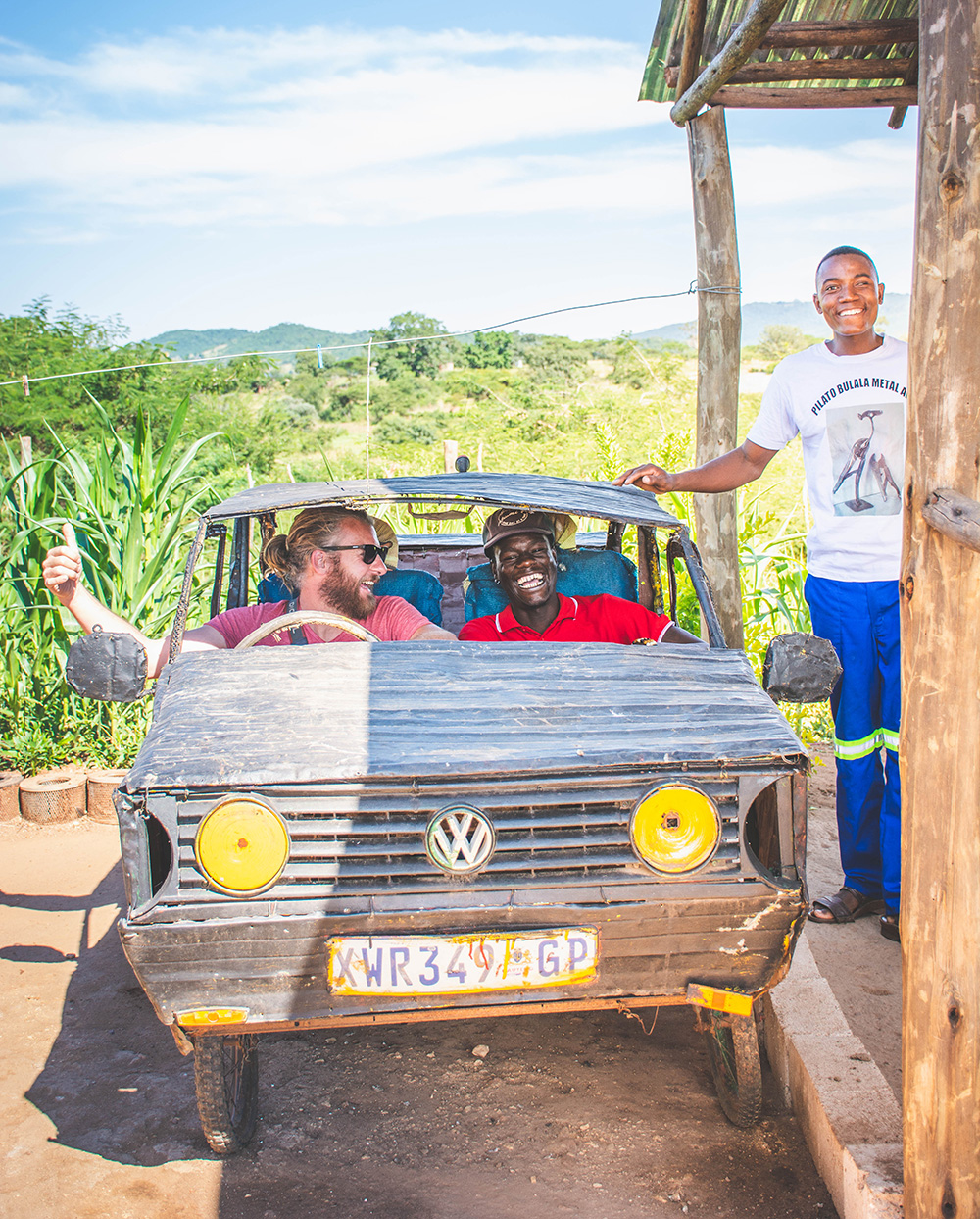 Deon Pienaar, Rhulani Gift Mkhari and Pilato Bulala take a spin inside one of Pilato's early scrapture creations, a VW Golf