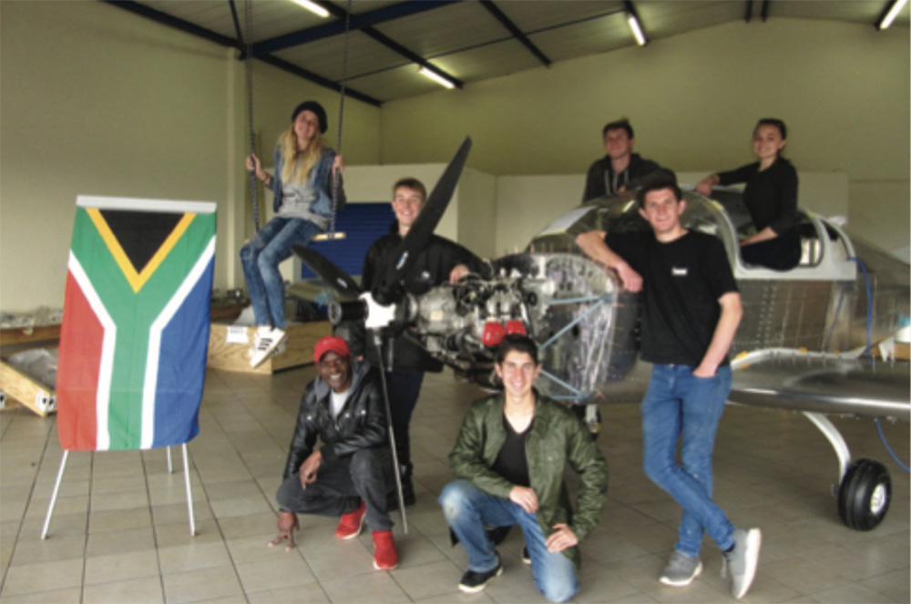 Some of the teens with their Sling-4 aircraft