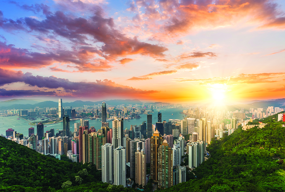 View of Hong Kong and Victoria Harbour at  sunset.