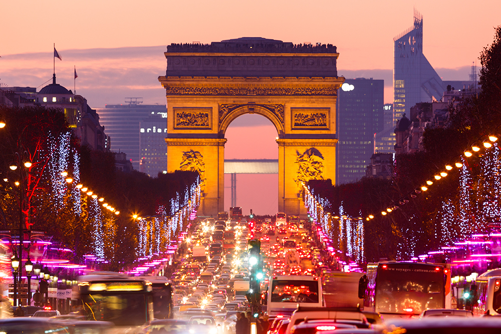 Traffic on street at dusk, Paris, France