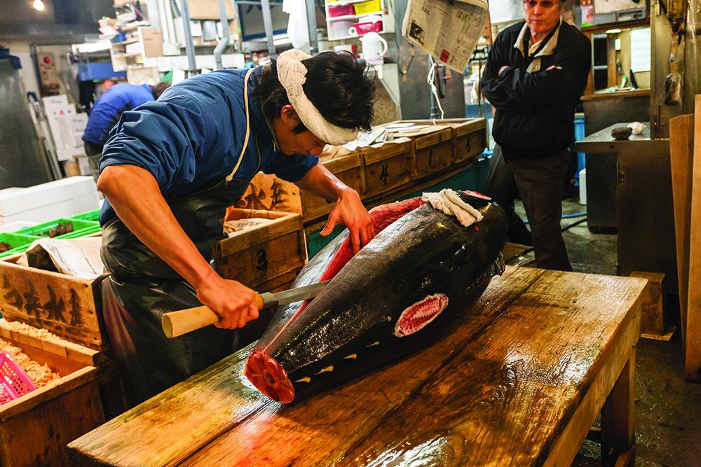 Cutting tuna at Tsukiji Fish Market. Tokyo, Japan