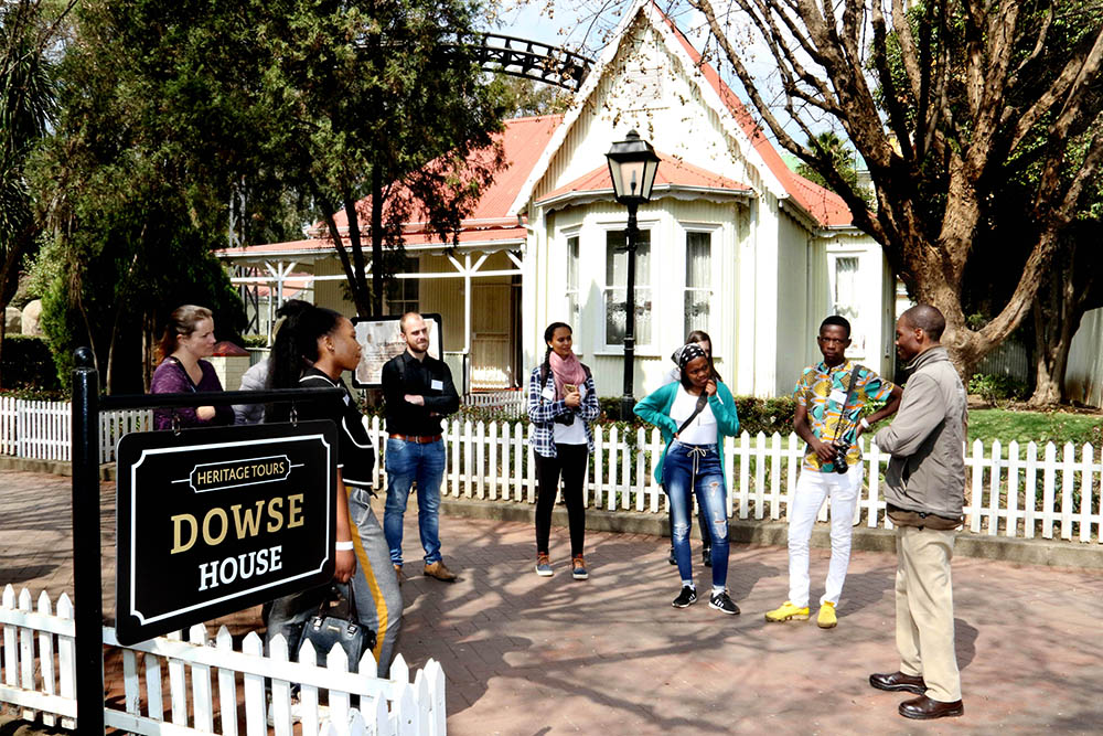 A heritage tour group in front of the Dowse house