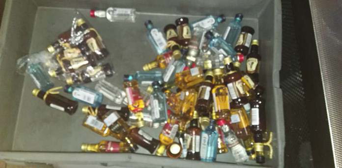 A total of 47 bottles of liquor miniatures that were found on a security officer for an international airline.