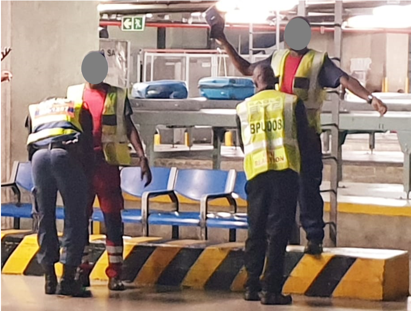 A random stop-and-search being carried out in one of the baggage handling areas.
