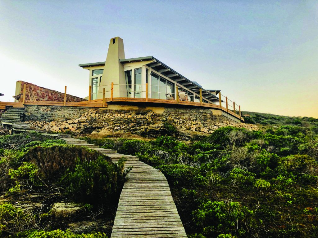 the main house and wraparound deck at Lekkerwater, as seen from the boardwalk